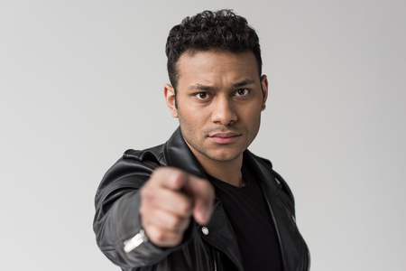 portrait of serious african american man pointing isolated