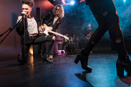 multiethnic rock and roll band performing concert on stage Stock Photo - 79317151