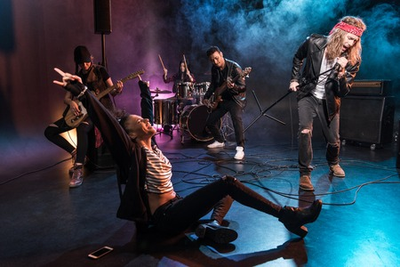 multiethnic rock and roll band performing concert on stage Stock Photo - 79317122