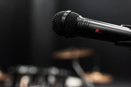 black electric microphone on empty stage Stock Photo - 79316538