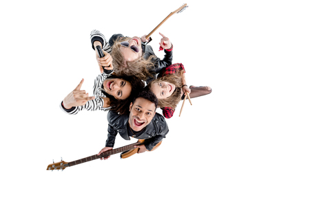 Overhead view of happy young rock and roll band posing with instruments Stock Photo