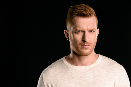 portrait of handsome redhead man looking at camera