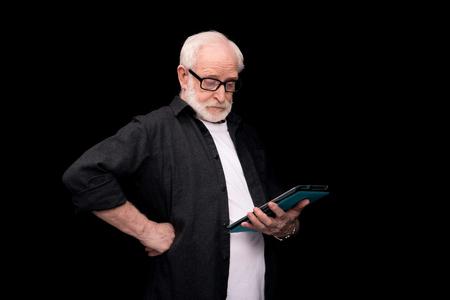 senior man using tablet Stock Photo