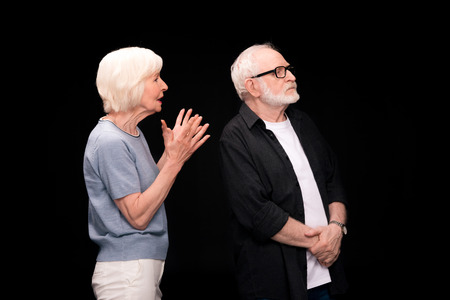 Senior couple gesturing Stock Photo