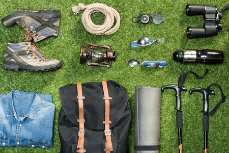 scouting: Traveler set on grassy background, flat lay