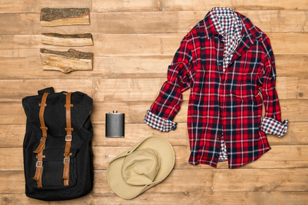 scouting: Traveler set on wooden background, flat lay