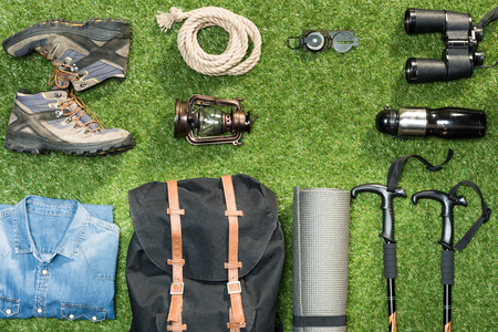 Traveler set on grassy background, flat lay