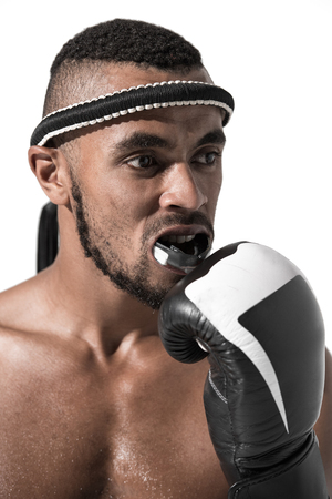 portrait of muay thai fighter fixing mouth guard Stock Photo