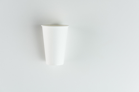 plastic disposable cup isolated on grey
