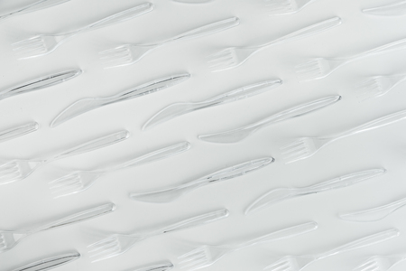 set of various plastic cutlery isolated on white