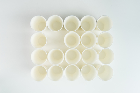 empty plastic cups isolated on grey Stock Photo