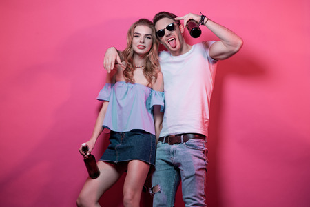 young stylish couple at casual clothes posing and fooling around