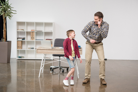 Man freelancer having fun with son
