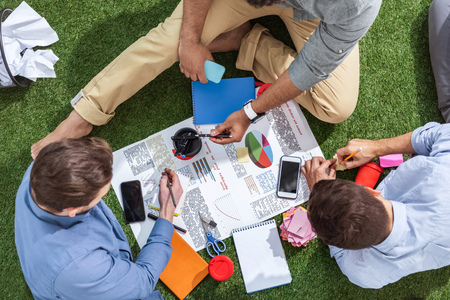 overhead view of business people working on new business plan, business teamwork Stock Photo