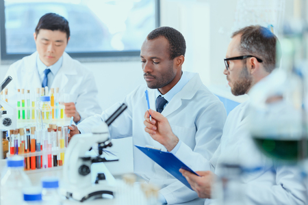 young doctors in uniform working at testing laboratory