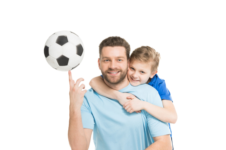 father and son posing with soccer ball isolated on white Stok Fotoğraf