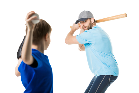 father ready to hit the ball by baseball bat Stock Photo