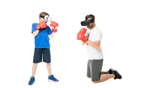 side view of father and son boxing in virtual reality headsets Stock Photo
