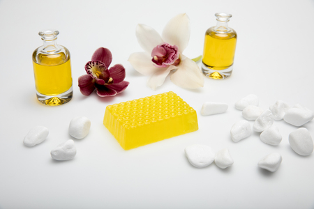 Close-up view of homemade honey soap with essential oil and orchids isolated on white Stock Photo