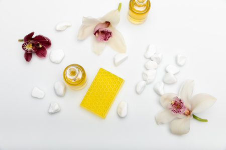 Top view of homemade honey soap with essential oil and orchids isolated on white