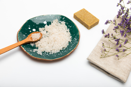 Close-up view of dried lavender flowers with sea salt and handmade soap isolated on white Stock Photo