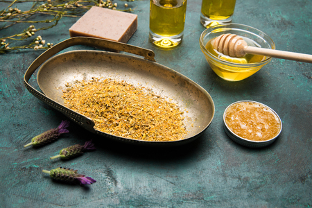 Close-up view of dried petals, homemade soap and honey for skin care Stock Photo