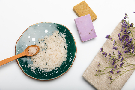 Close-up view of handmade soap with sea salt and dried lavender isolated on white