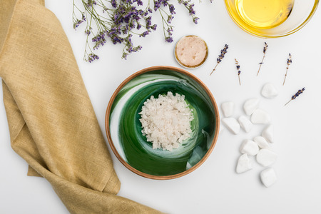 Top view of sea salt, dried lavender, white stones and cloth isolated on white Stock Photo