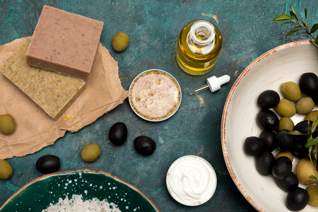 Close-up view of sea salt, handmade soap and olives for homemade cosmetics