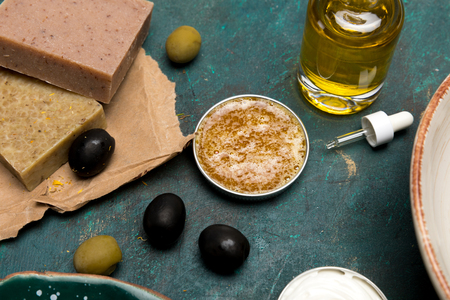 Close-up view of oil, handmade soap and olives for homemade cosmetics Stock Photo