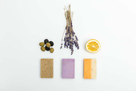Top view of three types on homemade soap with dried lavender, olives and lemon isolated on white Stock Photo