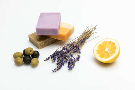 Close-up view of three types on homemade soap with dried lavender, olives and lemon isolated on white Stock Photo
