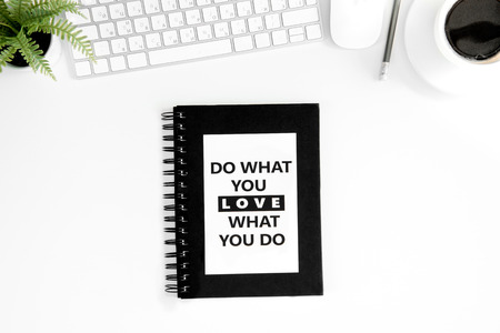 flat lay with do what you love what you do motivational quote on diary