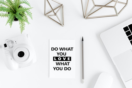 Top view of do what you love, love what you do motivational quote