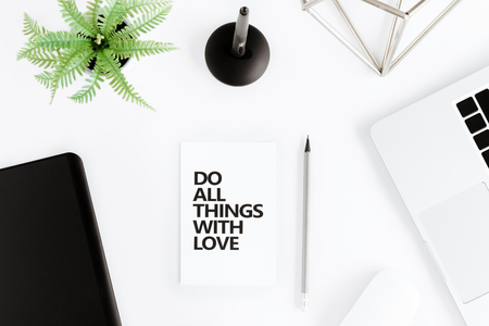 all love: flat lay with Do all things with love motivational quote Stock Photo