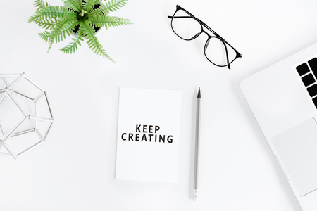 flat lay with Keep creating motivational quote Reklamní fotografie