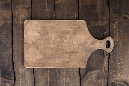 Top view of old scratched chopping board