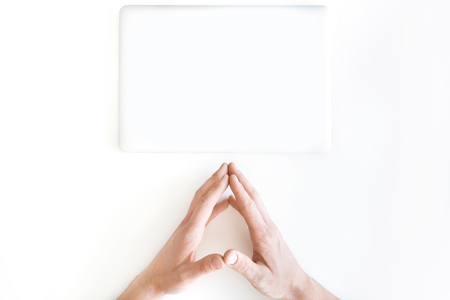 partial: top view of human hands and laptop computer isolated on white Stock Photo