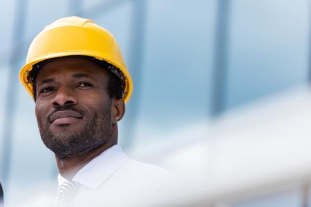 professional architect in hard hat looking away Standard-Bild