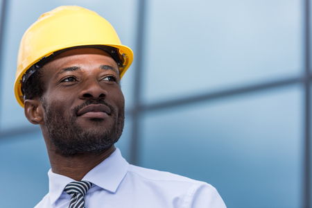 professional architect in hard hat looking away Stok Fotoğraf