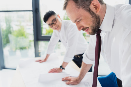 architects in formal wear working at modern office