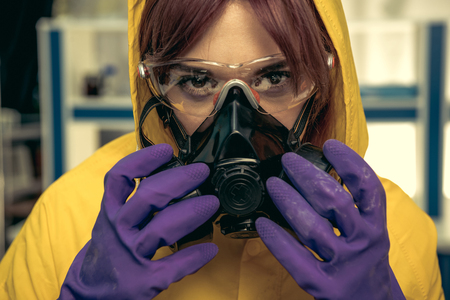 young girl laboratory technician in personal protective equipment Stock Photo