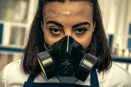 young girl laboratory technician in personal protective equipment Stok Fotoğraf