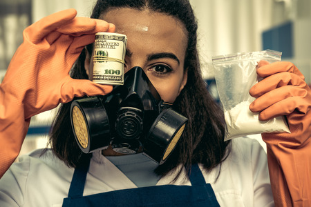 obscure: young girl laboratory technician in personal protective equipment Stock Photo