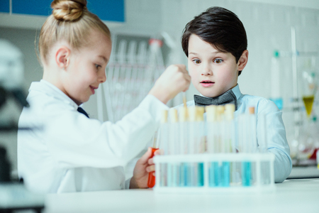 schoolchildren with science lab equipment in chemical lab 写真素材
