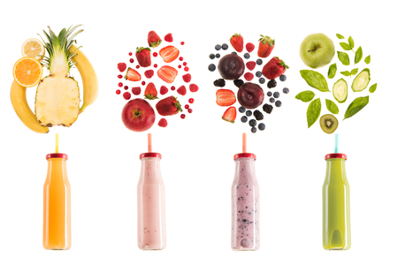 different healthy smoothies in bottles with fresh ingredients isolated on white, fresh fruit smoothie concept