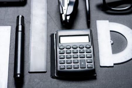 calculator with various office utensils mock-up Фото со стока