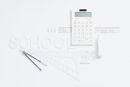 calculator with rulers and stapler with compasses mock-up Фото со стока