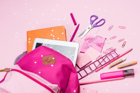 various school supplies in schoolbag