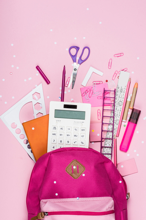 various school supplies in schoolbag